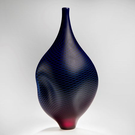 modern glass vase with wide midrift and narrow base and top in dark purple