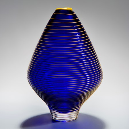 minimalist short electric blue glass  vase sculpture with faint yellow horizontal line pattern