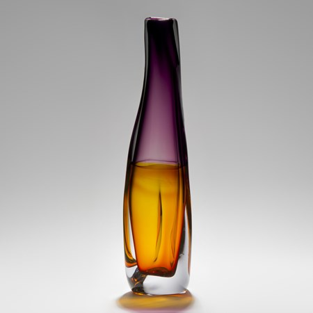tall sculpted glass vessel in orange and purple