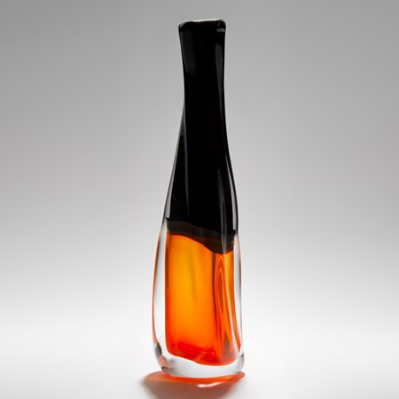 art-glass vase sculpture with bright orange bottom and black upper section