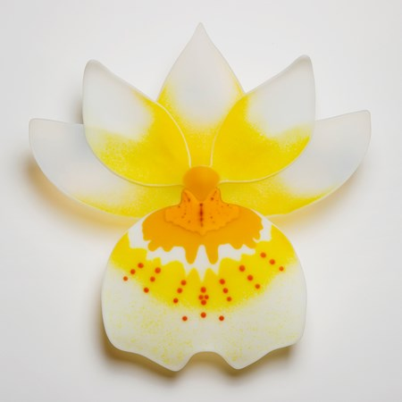 glass sculpture of pansy flower in yellow and white