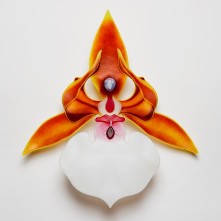 glass art sculpture of an exotic flower in white and orange