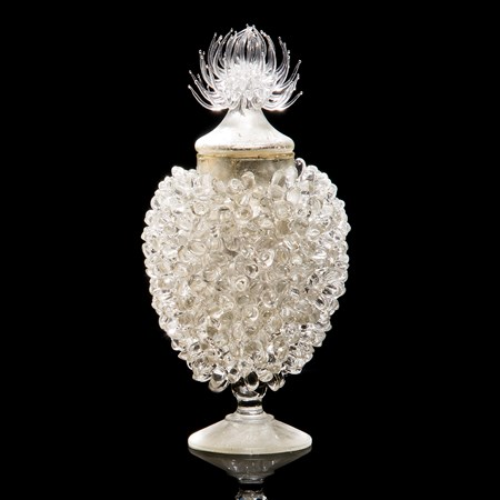 whiite glass sculpture of prickly centred jar with steel gilding
