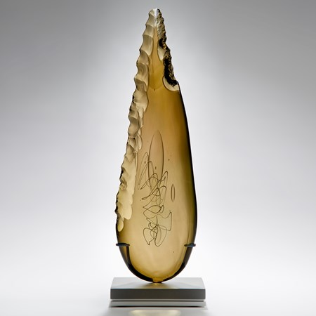 bronze leaf shaped art glass sculpture on grey base