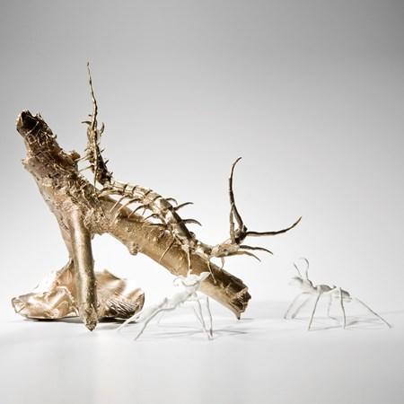 artwork of bronze centipede with glazed porcelain ants.