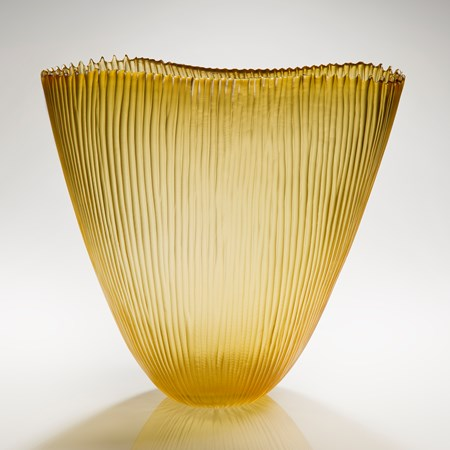 cut glass tall fin bowl in gold with thin ribbed external pattern
