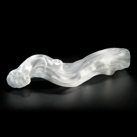 experimental art glass sculpture of long curved form in white