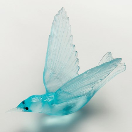 light blue art glass sculpture of a bird