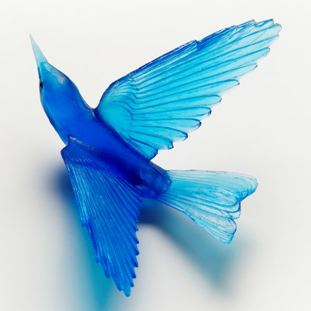 glass sculpture of a bell bird in blue