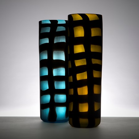two blown art glass vases in electric blue and dark yellow with black checked pattern