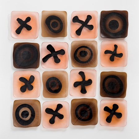 wall-mounted glass art sculpture resembling chocolate box in white brown and rose pink