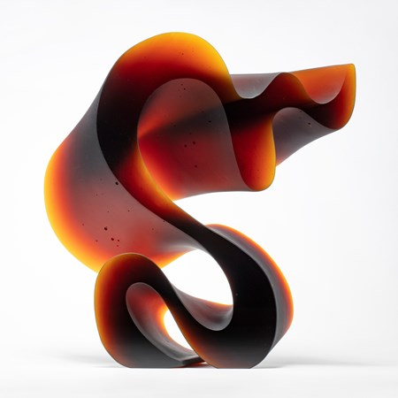 abstract contemporary glass art sculpture in red and black