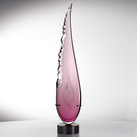 sculpted pink glass in upright feather shape resting on black metal base
