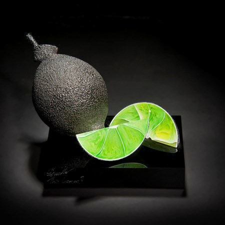 glass sculpture of lime as still life piece of art