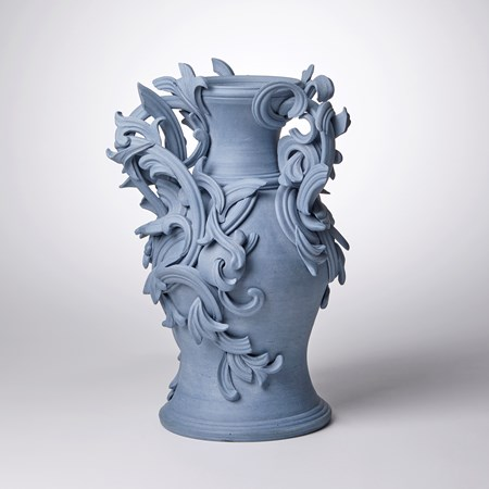 blue ceramic vase with decorative classical trim