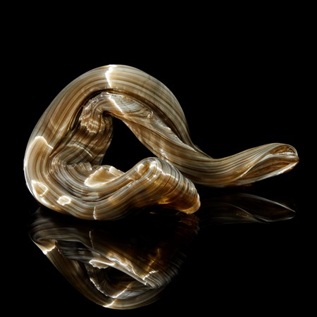 glossy bronze organic ridged twisting candy like sculpture handmade from glass