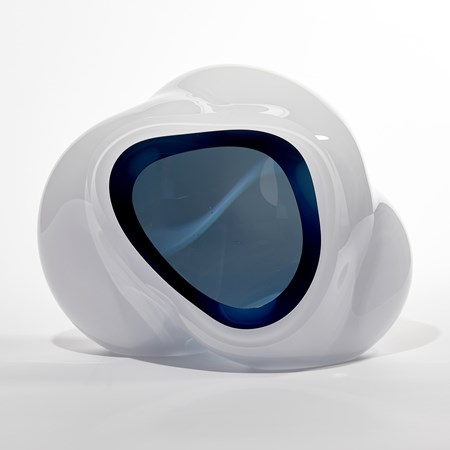cloud like soft white form with turquoise interior sculpted from blown glass
