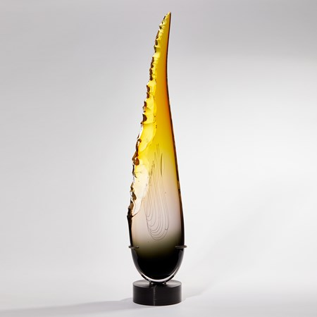 tall pointed teardrop shaped sculpture in grey and yellow with chipped edge handmade from glass