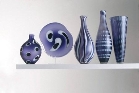 five purple hand blown glass vases in different shapes and patterns